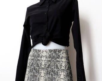 snake print mini skirt. size xs small.
