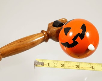 Toy top. Wood spinning top with handle. Halloween toy
