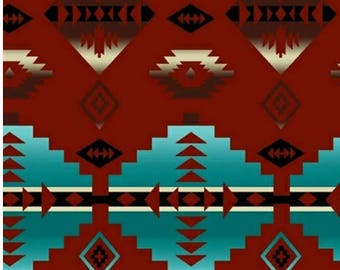 Fleece with Native American design in red and turquoise.