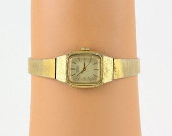 Seiko wrist watch Ladies Bracelet style band Gold metal Quartz, Japanese Made, Vintage excellent working condition, Seiko Time Corp.