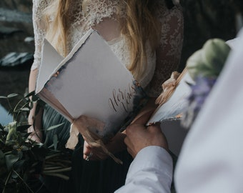 Handpainted wedding vow books with calligraphy