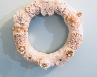 Spring wreath shabby chic with vintage laces, trims, and buttons
