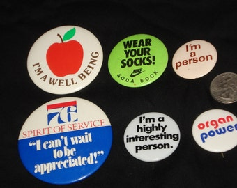 Collection of Interesting Sayings Buttons from the 1970's