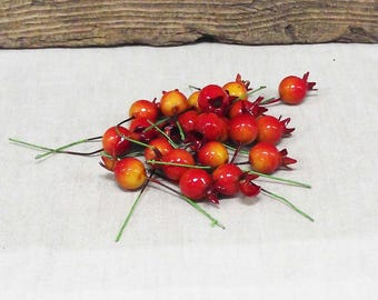 Orange Cranberry Glass Fruit Picks in a Package of 20.