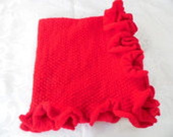 Red blanket with ruffled edge