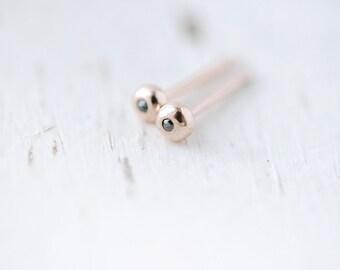 Tiny black diamonds in Rose gold earrings