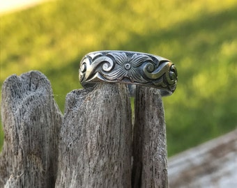 Sterling silver engraved ring band.