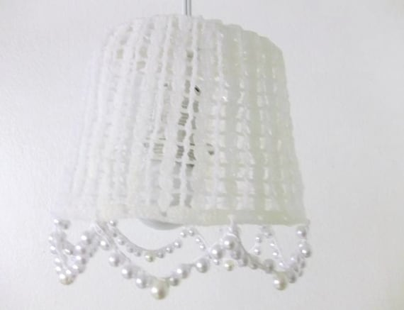 Crochet hanging lamp shades in a white color with hanging