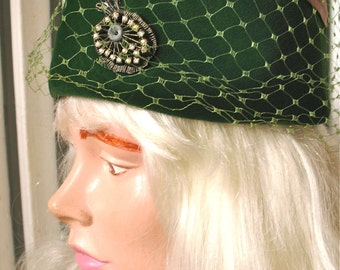 Burnett | Vintage 1960s Green Velvet Pill Box Hat with Veil and Rhinestone Decoration
