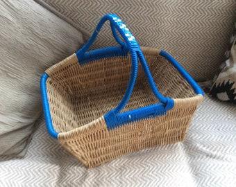 Original 1950s vintage wicker shopping basket blue trim.