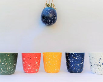 "Hand painted ""Splash of summer"" Splatter plant pots.Yellow,dark green,dark blue,white and peachy pink with white,black and gold splatter."