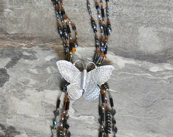 Silver Butterfly on multistrand beaded necklace