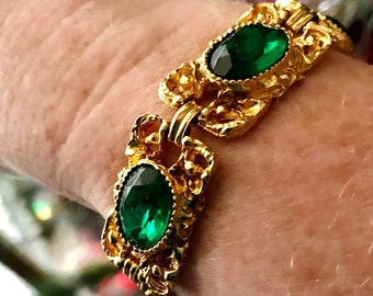 Vintage gold tone medieval style metal bracelet, faceted green stones, steampunk, costume jewellery, old Hollywood