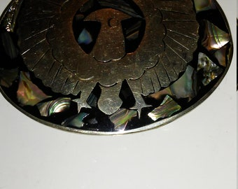 Sterling silver belt buckle/Thunderbird with abalone. From Mexico.
