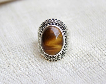 Oval shape tiger's eye natural gemstone set in sterling silver handmade designer ring available in all ring sizes