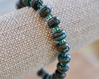 Green and bronze handmade lampwork glass bead and Swarovski crystal bracelet with gold vermeil hook and eye clasp