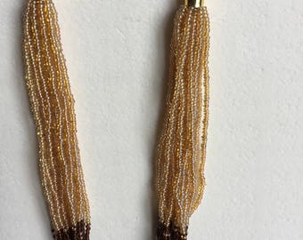 Handwoven necklace homogeneous, modern and ethnic beads
