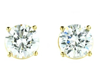 A pair of 14k yellow gold 8mm round CZ studs.