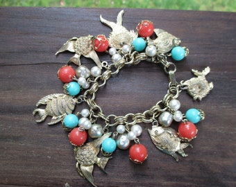 Tropical fish charm bracelet with beads and faux pearls