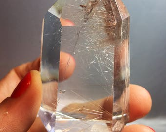 Rutile with emerging crystal inside item825