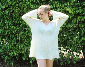 White flowy 70s flared sleeved sweater