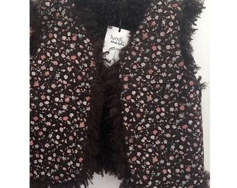 Shepherd reversible vest faux fur comforter and chocolate flowers