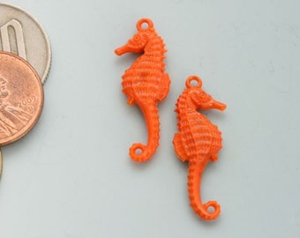 Seahorse charms from Germany, made from old molds. Coral sea horses for jewelry making and altered art projects.