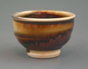 Teacup, woodfired porcelain w/ tenmoku and natural ash glazes