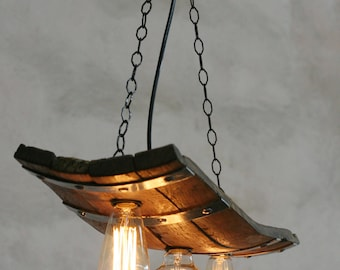 Rustic ceiling lights. Wine barrel with 3 lights