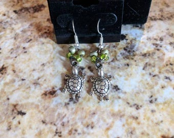 Dangle earrings - silver turtles with green seed beads