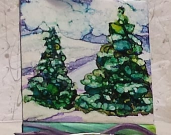 Winter Splendor depicted with alcohol ink on ceramic tile