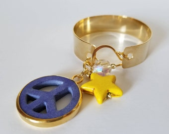 Bronze foil bracelet with gold plating and peace symbol