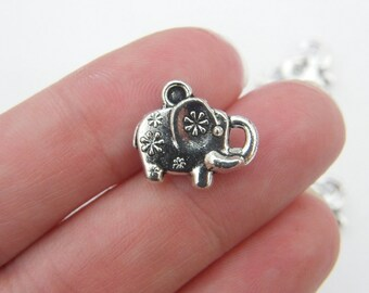 8 Elephant charms antique silver tone A534