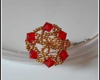 Oriental red and gold ring