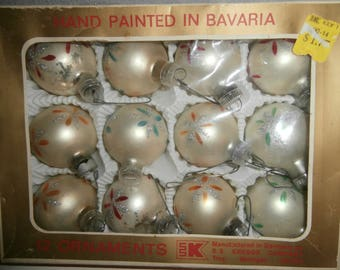 Vintage hand painted in West Germany design reds blues oranges with glitter Poinsettia?  Baverian Christmas glass ornaments