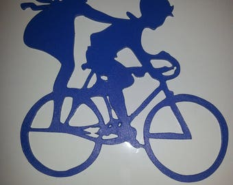 silhouette of a boy and girl on the same bike. Hand cut 3 mm medium, and painted