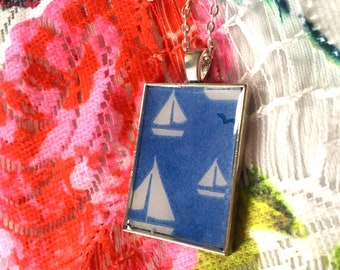 Sailing boat pendant necklace blue and white.