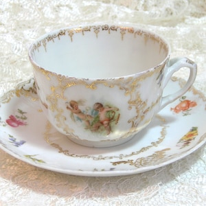 Cherub Teacup And Saucer