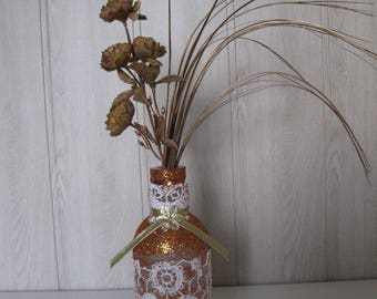 glass vase/bottle laces glitter and the stem flowers and ruffle