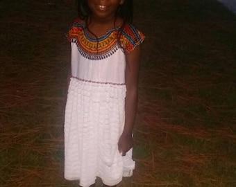 White African Dashiki print ruffle dress.