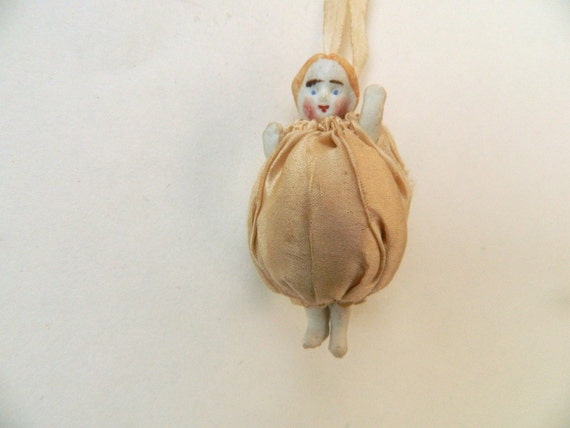 Antique Mini Bisque & Ivory Silk Cushion Doll Necklace