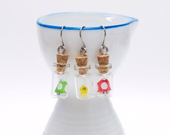 Origami Mario bros mix and match earrings in tiny glass bottle