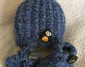 Baby hat and booties with faux fur pom pom