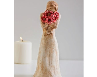 A Girl Holding Red Flowers Sculpture