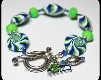 Seattle Seahawks... Handmade Jewelry Bracelet Beaded Polymer Clay Crystal Blue Lime Green Silver Swirl Spiral Football Team Fan NFL 12th Man
