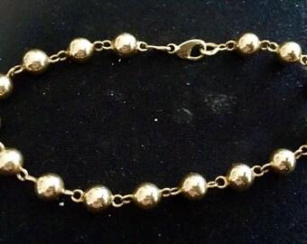 Bracelet beads, gold balls, Eagle head punch, solid 18 k 750/000