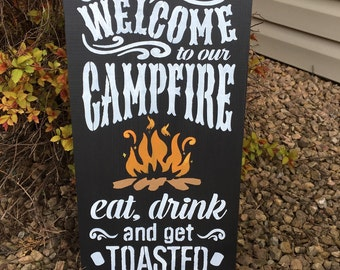 Welcome to our campfire sign, get toasted sign