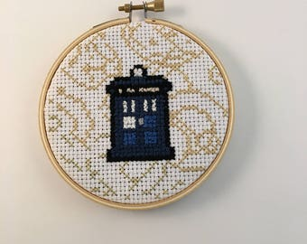 Handcrafted Cross-Stitch TARDIS with Time Lord Words in Background