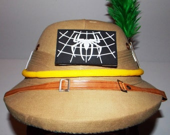 Pick of 6, British military Army khaki pith helmet,size 7 1/8, leather straps-liner,green feather hackle -patch holder of clover,union jack.