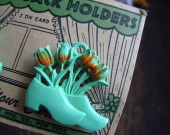 Vintage Plastic Turquoise Dutch Shoe with Tulips Curtain Tie Back Holders